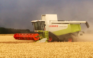 James knight farms with Combine harvester at United Kingdom