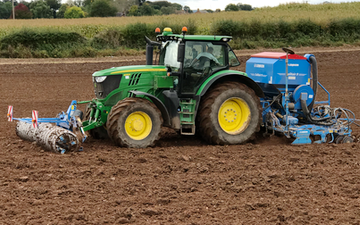 David marshall agricultural contractor with Drill at Albrighton