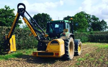 K.r.sharratt agricultural services  with Hedge cutter at Gnosall