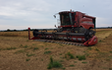Aldburys farm contracting  with Combine harvester at United Kingdom