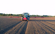 Stud farm contracting  with Tractor-mounted sprayer at United Kingdom