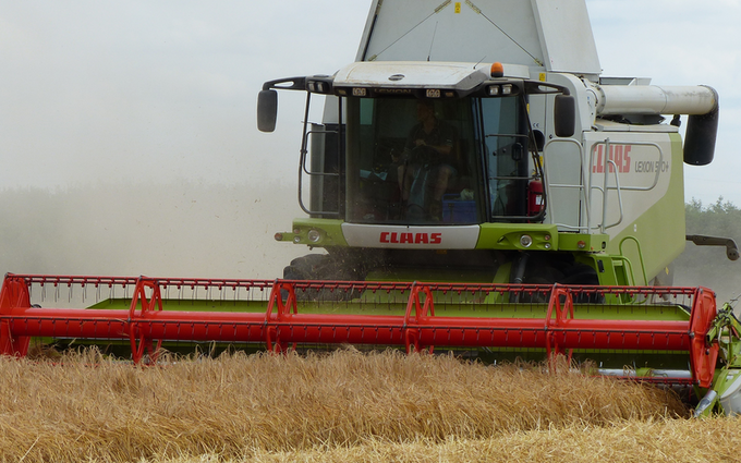 A r belton and son with Combine harvester at Ealand