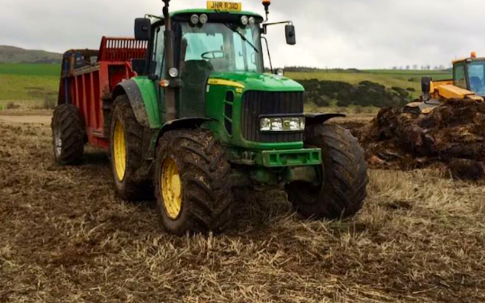 Reid contracting  with Manure/waste spreader at Ballencrieff