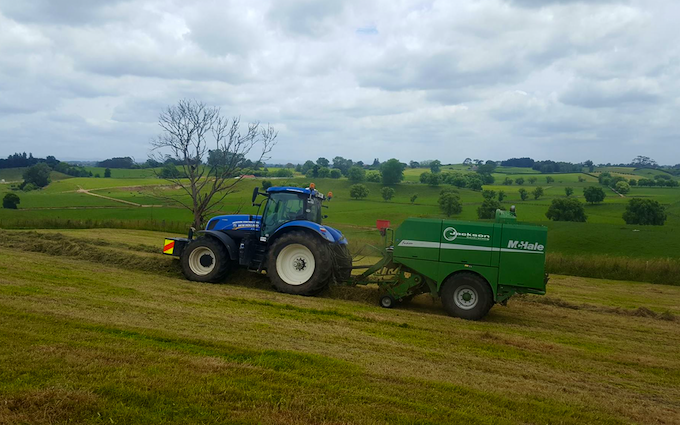 Jackson contracting  with Round baler at Tauhei