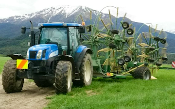 Mid canterbury baling ltd with Rake at Cavendish
