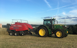 R.m simpson agriculture ltd with Large square baler at Hunsworth Lane