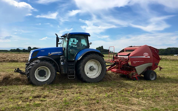 Mckenzie brooker contracting  with Round baler at Oxford