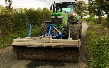 Manford farm contractors  with Sweeper at Oswestry