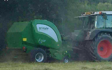 Nixon farms with Round baler at Builth Road