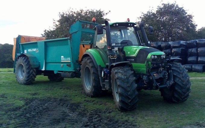 Belsham farming with Manure/waste spreader at United Kingdom
