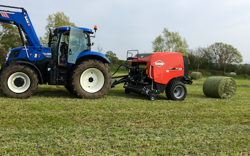 Zac bessell agricultural services with Round baler at United Kingdom