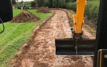 Lj ag  with Excavator at United Kingdom