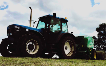 Rowlinson  contractors  with Round baler at Cotton