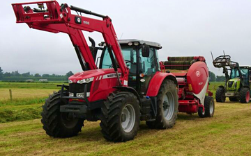Mid canterbury baling ltd with Round baler at Cavendish
