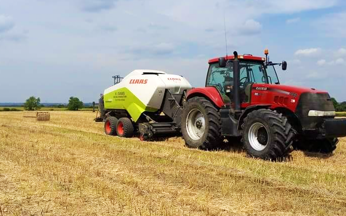 H evans contracting  with Large square baler at Grandborough Fields Road