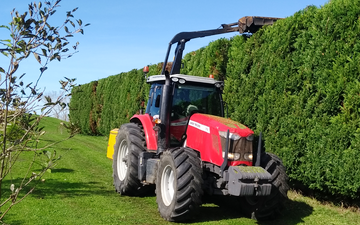 Hyland hedgecutting ltd with Hedge cutter/mulcher at Aka Aka