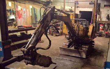 Tinkerdal smede og maskinværksted  med Minigraver ved Holstebro