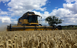 Haydn wesley & son ltd with Combine harvester at Millthorpe Drove