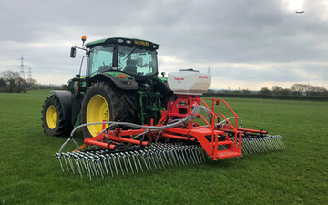 Rob hayton agricultural services with Tine harrow at United Kingdom