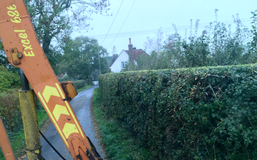 E white contracting services  with Hedge cutter at Ponts Green