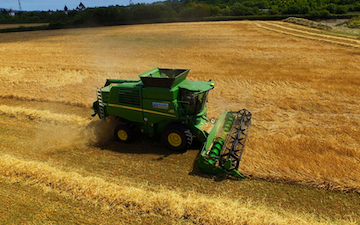 Wildwoods contractors with Combine harvester at United Kingdom