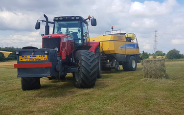 M.e.agri ltd with Large square baler at Ludgershall