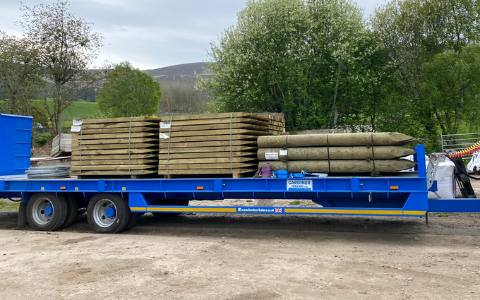 Wee jim landscapes with Low loader at United Kingdom