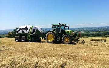 John clements contracting ltd with Large square baler at Camomile Way