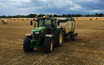 A. farrell contracting with Round baler at Hellington