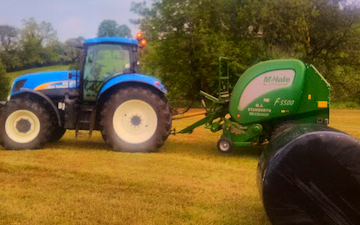 M. j. stanworth agricultural contractor with Round baler at Foulridge