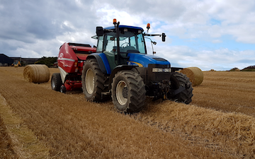 Ewen j fraser with Round baler at United Kingdom