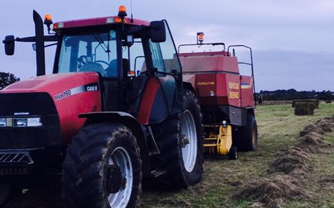 L mcquarrie agricultural services  with Large square baler at United Kingdom