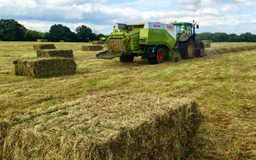 Manford farm contractors  with Large square baler at Oswestry