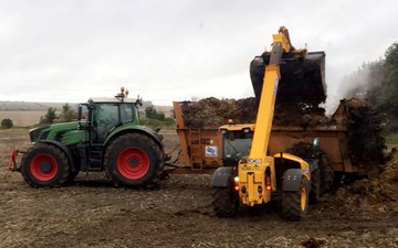 A t contracting with Manure/waste spreader at Berryfield Lane