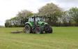Belsham farming with Tine harrow at United Kingdom