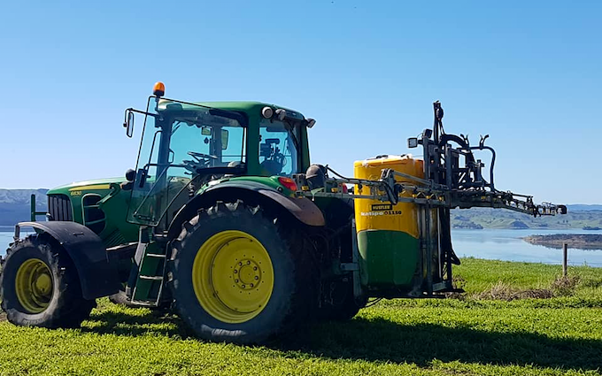 Cathcart contracting ltd  with Tractor-mounted sprayer at Waikokowai
