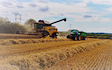 Oakfield contracting with Combine harvester at United Kingdom