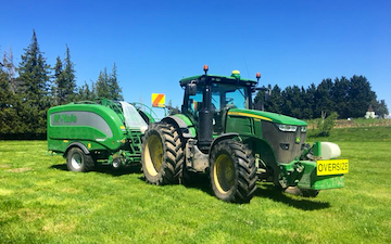 Joe herbert contracting ltd with Round baler at Kaikoura