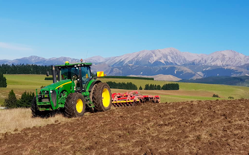 Chapman agriculture ltd  with Disc harrow at Cust