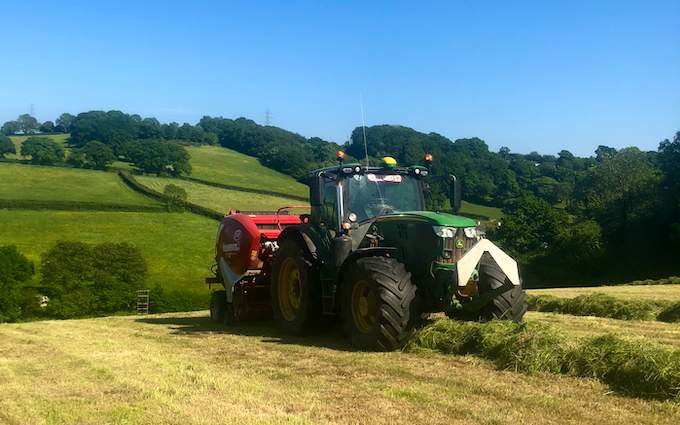 John clements contracting ltd with Round baler at Camomile Way