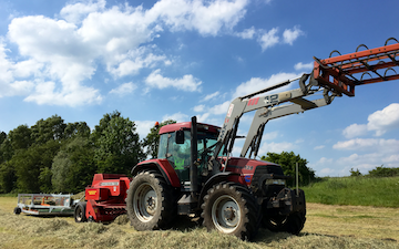 Grassland farm services with Small square baler at Greenland Lane