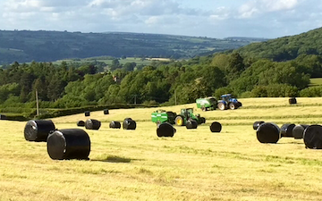 M g ricketts  with Round baler at Glasbury