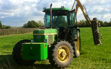 Dominic jeynes agricultural contracting with Hedge cutter at Longdon