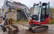 Ewen j fraser with Mini digger at United Kingdom