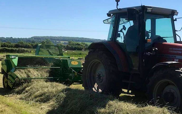 Jon richards contracting  with Small square baler at Hewish