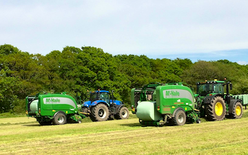 Hooftrimming ltd with Round baler at United Kingdom