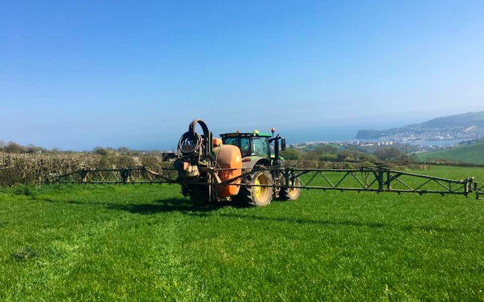 Wildwoods contractors with Tractor-mounted sprayer at United Kingdom