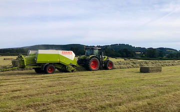 K m bray agri & plant contractor  with Large square baler at Talgarth