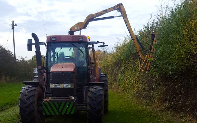 Cowton farming company  with Hedge cutter at North Cowton