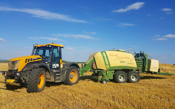 K h wendt agricultural contractor with Large square baler at Bishop Norton